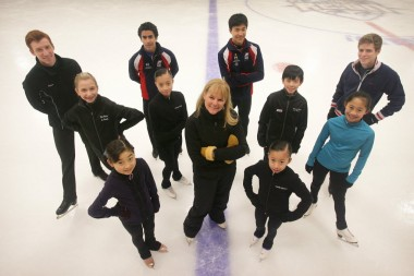 Tammy Gambill (center), with the 10 skaters she took to the recent U.S. National Figure Skating Championships. Back: Sean Rabbitt, Philip Warren, Shotaro Omori, Richard Dornbush. Middle row: Tyler Pierce, Elizabeth Nguyen, Vincent Zhou, Amy Lin. Front row: Ai Setoyama, Caitlin Nguyen. (Staff photo: Stan Lim)